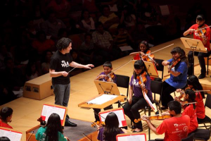PHOTO by Mathew Imaging: LA Philharmonic conductor Gustavo Dudamel leads children in the Youth Orchestra of Los Angeles.