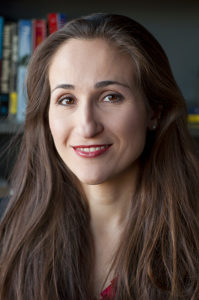 Mindy Romero, headshot style photo, she is looking into the camera and smiling.
