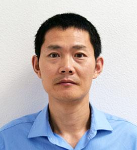 Hongqiao Zhang, MD, PhD, portrait photo.