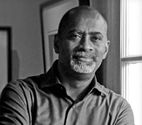 Ricky Bluthenthal, portrait in black and white.