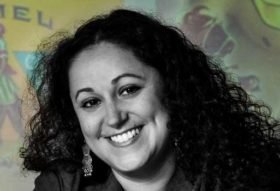 Evelyn Alsultany, Associate Professor, American Studies and Ethnicity, black and white portrait photo with colored background.