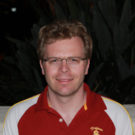 Headshot style photo of Ralf Haiges, Associate Professor of Chemistry at the USC Dornsife College, wearing a USC polo.